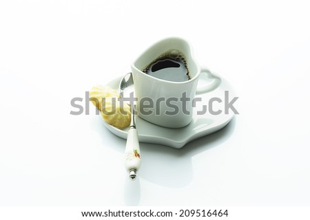 Coffee cup in heart shape - stock photo