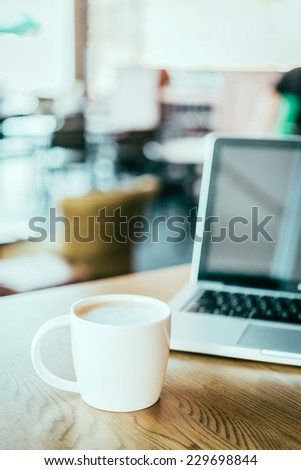 Coffee cup , laptop in coffee shop - vintage effect style pictures