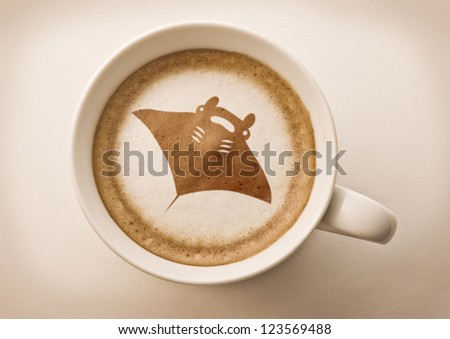 coffee cup latte art, manta ray drawing - stock photo