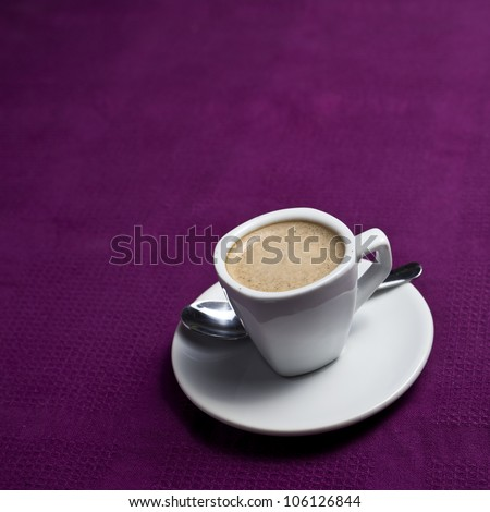 Coffee cup on a purple background - stock photo