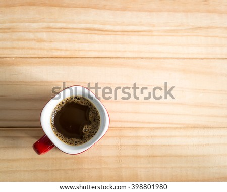 Coffee cup on a wood background., Flat lay. - stock photo