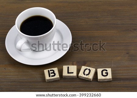 Coffee cup on a wooden table and text - BLOG - stock photo
