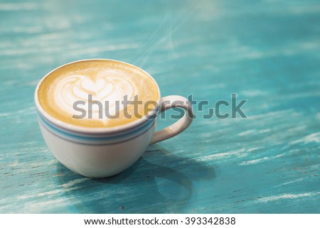 Coffee cup on a wooden table  background,Vintage color tone - stock photo