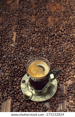 Coffee cup on coffee grains background - stock photo