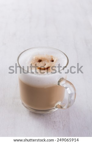 Coffee cup on grunge white wooden board - stock photo