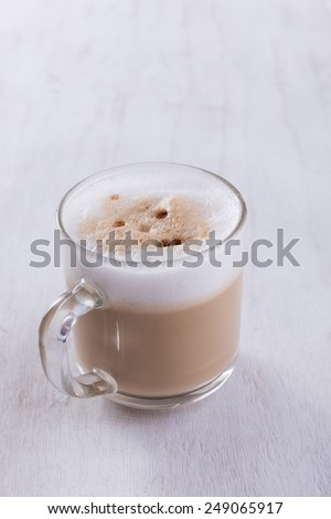 Coffee cup on grunge white wooden board