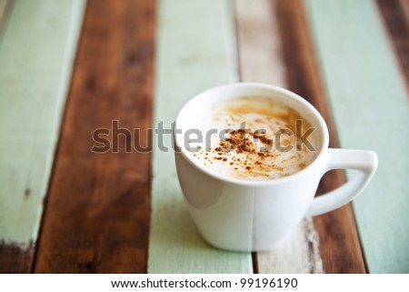 Coffee cup on grunge wooden table - stock photo