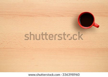Coffee cup on office desk top view