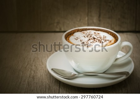 Coffee cup on old wood table background