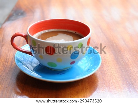 Coffee cup on old wooden - stock photo