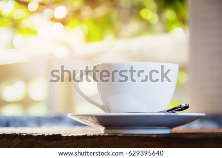 Coffee cup on old wooden table the good morning