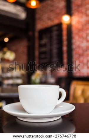 Coffee cup on the table at the coffee shop - stock photo