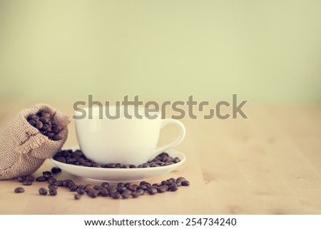 Coffee cup on the table- vintage style effect picture - stock photo