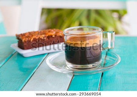 Coffee cup on white blue table - stock photo