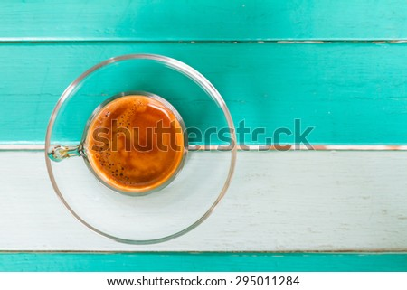 Coffee cup on white blue table taken in top view - stock photo