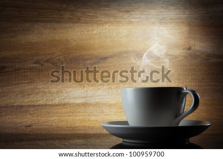Coffee cup on wooden background - stock photo