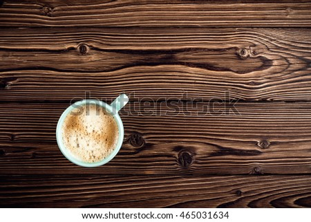 coffee cup on wooden background top view