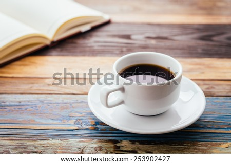 Coffee cup on wooden background - vintage effect