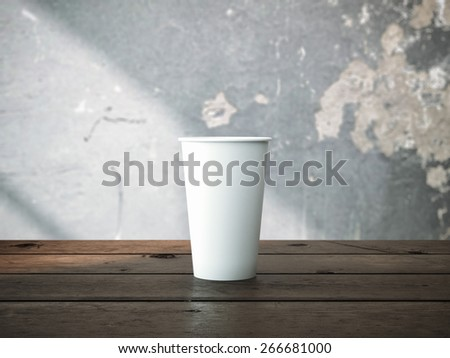 coffee cup on wooden table - stock photo