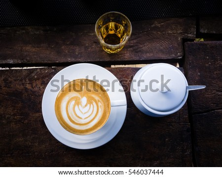 Coffee cup on wooden table, artistic photo