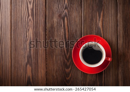 Coffee cup on wooden table background. Top view with copy space - stock photo