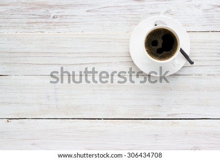 Coffee Cup on Wooden Table Background, View from above with copy space. - stock photo