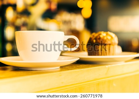Coffee cup on wooden table in coffee shop - Vintage effect style pictures - stock photo