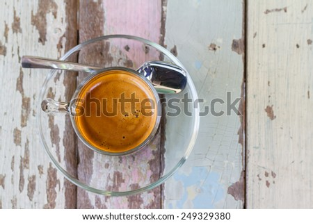 Coffee cup on wooden table in top view - stock photo