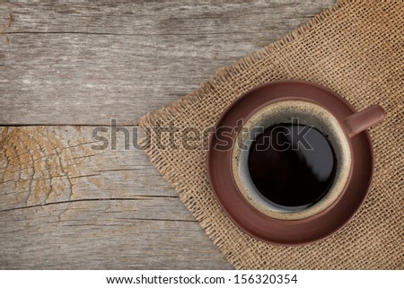 Coffee cup on wooden table texture. View from above - stock photo