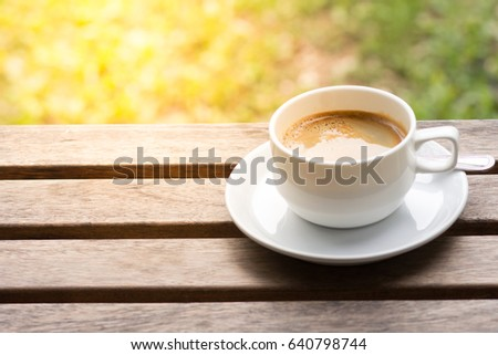 Coffee cup on wooden tablel background