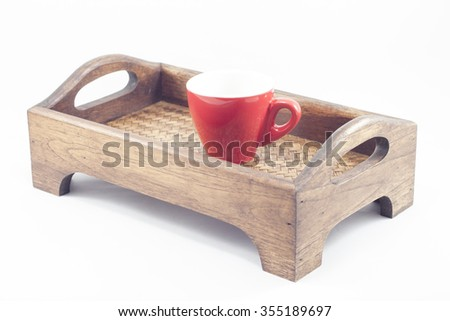 Coffee cup on wooden tray isolated on white background, stock photo