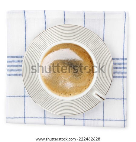 Coffee cup over kitchen towel - isolated on white background  - stock photo