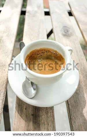 Coffee cup placed on wooden table