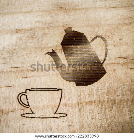 coffee cup  Sculpture on wood. - stock photo