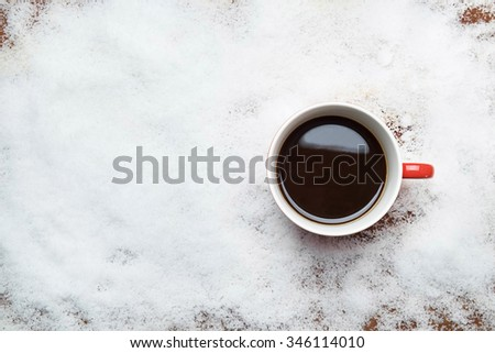 Coffee cup top view on snow - stock photo