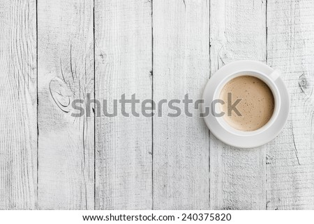 coffee cup top view on white wood table background - stock photo