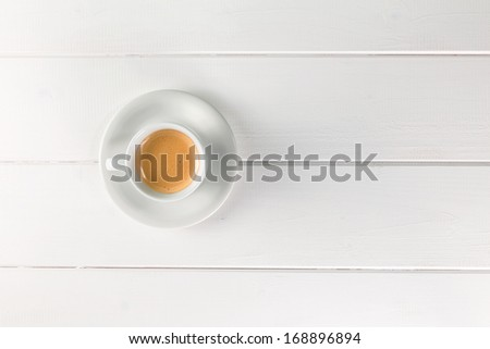 Coffee cup top view on withe table - stock photo