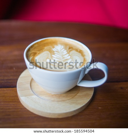 coffee cup view on wood table - stock photo
