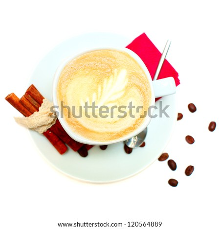 Coffee - cup with art pattern, beans and cinnamon