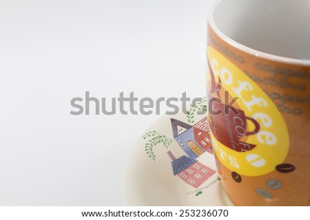 Coffee cup with beautiful paint on isolate background.  - stock photo