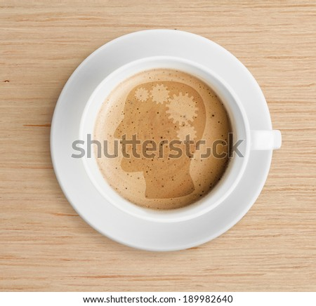 coffee cup with brain refreshing concept on foam - stock photo