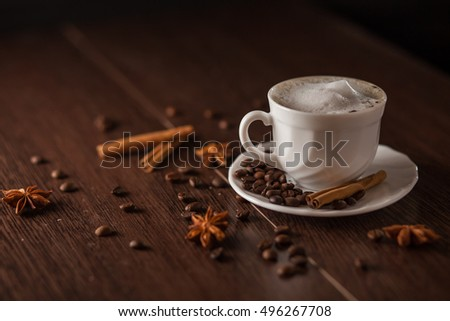 Coffee Cup with cinnamon on dark background