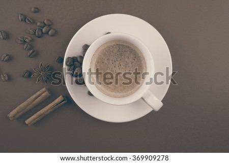 Coffee cup with cinnamon sticks and star anise vintage effect