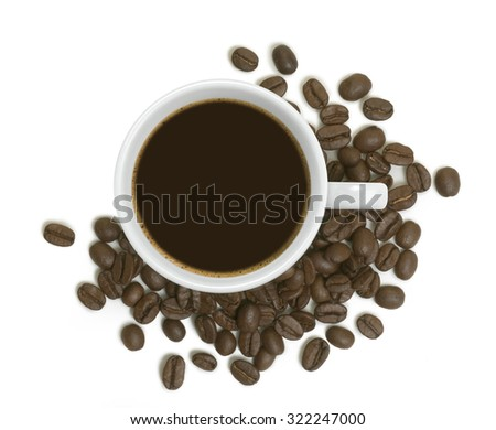coffee cup with coffee beans around  - stock photo