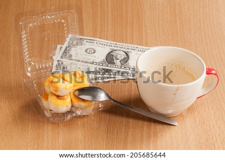 coffee cup with cookie on wood table. - stock photo