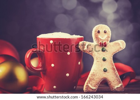 Coffee cup with cookie. Photo in retro color style. - stock photo