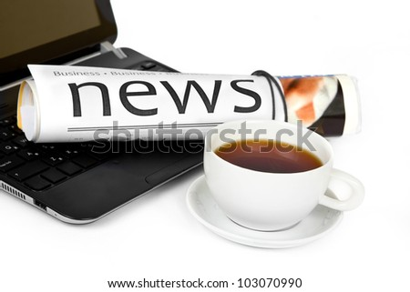 Coffee cup with laptop and newspaper - stock photo