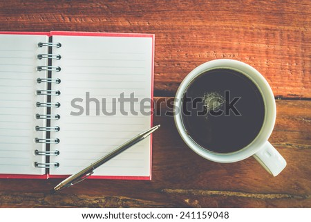 Coffee cup with note book - Vintage effect style pictures - stock photo