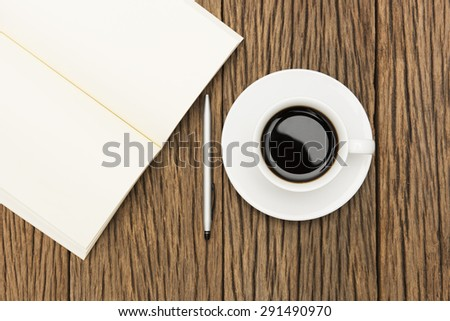 Coffee Cup With Notebook and Pen On Wood Background - stock photo