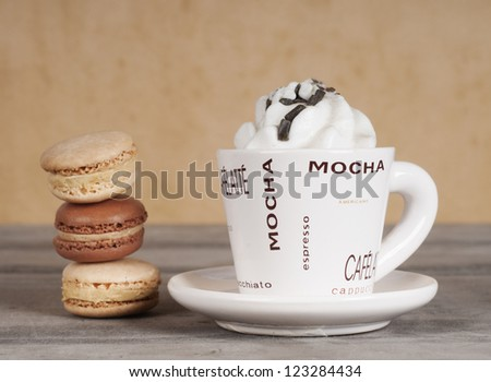 coffee cup with pile of macaroons